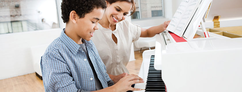 child taking piano lessons slide